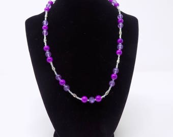 Purple beaded necklace with clear and silver accents