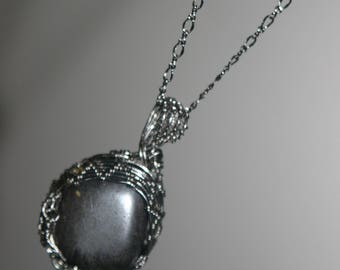 Pendant on a chain with a stone, Hematite.Wire wrap art.