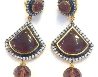 Maroon bead with CZ stones and a crystal dangling