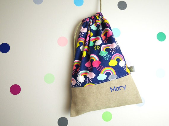 Customizable drawstring pouch - kindergarden - rainbows - navy blue - pink - clouds - rain - school - cuddly toy - slippers - toys