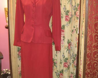"""1940's, 40"""" bust, cranberry colored gaberdine suit."""