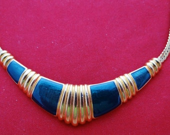 """Vintage 17.5"""" gold tone necklace with tealish navy blue enameling in great condition, appears unworn, centerpiece is 2.75"""""""
