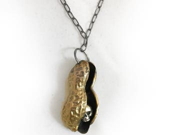 bronze peanut shell pendant with silver skull