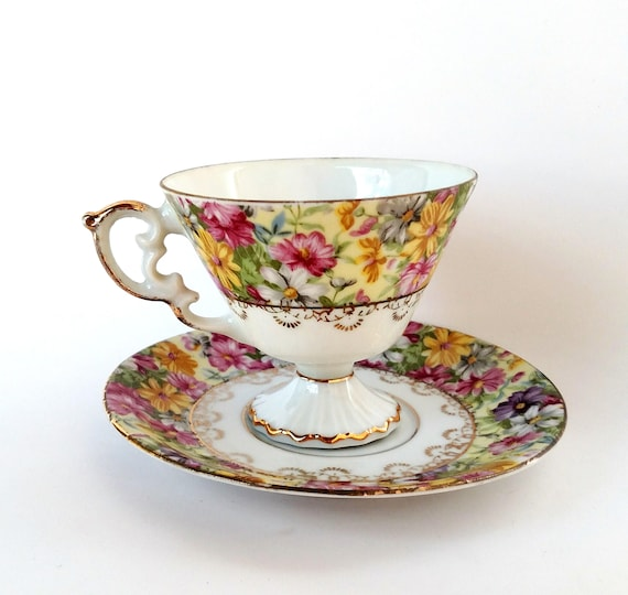 Vintage Teacup and Saucer Set with Colorful Floral Design and Gold Scrollwork Trim