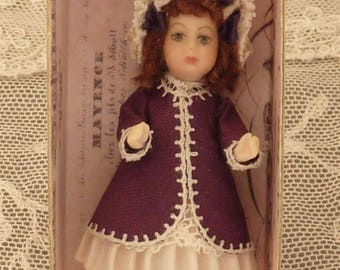 A miniature Bru reproduction doll