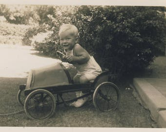 Little boy with toy car, Vintage photograph 1944