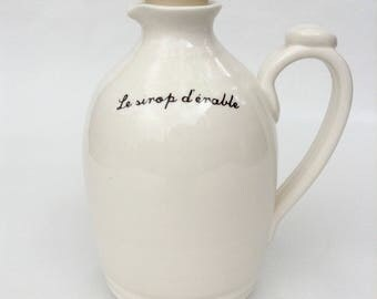 Jug for maple syrup with french or english inscription on white background