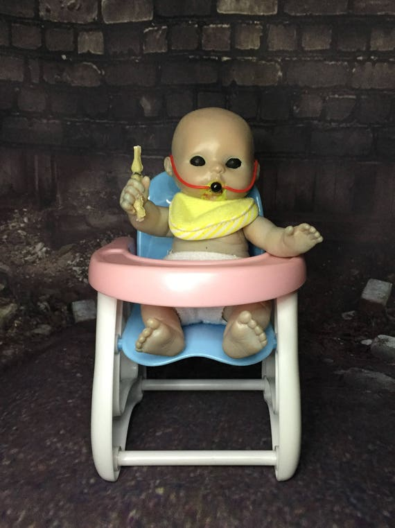 Mini Zombie Baby Doll Sitting In High Chair Fed Undead Gagged Biohazard Baby