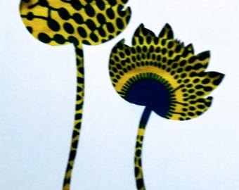 Flowers and a bee silhouette in yellow and blue African print fabric, cut paper art - living room art
