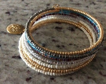 These seeds beads memory wire bracelets 8 layered