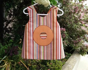 Lovely reversible wrap-around dress in orange and striped poplin.