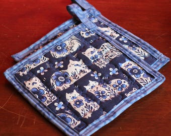 100% cotton quilted potholders in adorable blue cat print.