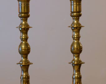 A Pair of 9.5 Inch-Tall Solid Brass Candlestick Holders