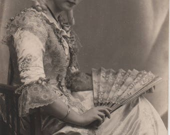 Baroque girl, theatrical costume, powdered wig, antique fan, sepia postcard, fancy dress, social history, collage ephemera  (rppc/gl263)