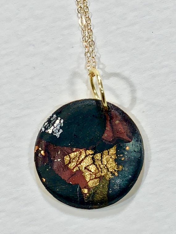 Handmade black/red/gray/gold/silver polymer clay round pendant necklace with abstract asymmetric design