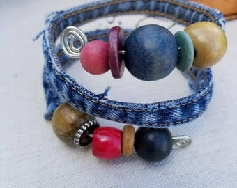 Recycled Denim Bracelet Made Using the Inseam of Blue Jeans Wrapped around Wire Featuring Recycled Wooden Beads