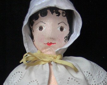 Lucy, a painted cloth doll