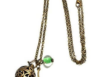 A scent! Necklace has perfume enameled flower, green bead