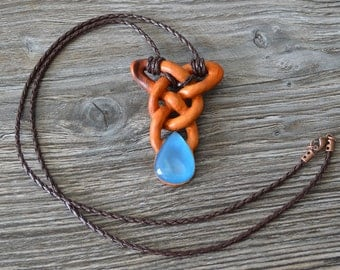 Boho wooden pendant with chalcedony on a leather cord.