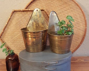 Brass wall planter set.  2 aged brass wall pokets.  Boho, eclectic, vintage wall planters