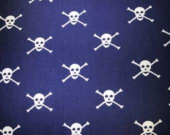 Skulls on dark blue fabric