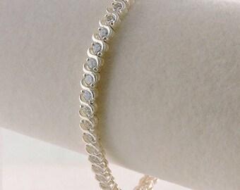 "Sterling Silver And 5cttw Rhinestone Tennis Bracelet 7 1/2"""