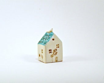 Tiny ceramic house with bird-white and green house
