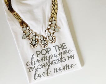 Pop the champagne i'm changing my last name, Pop the bubbly shirt. Bride T-shirt. Bride Shirt. Bride to be Gift. bachelorette party, bridal