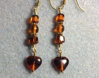 Orange brown striped Czech glass heart bead dangle earrings adorned with orange brown Czech glass beads.