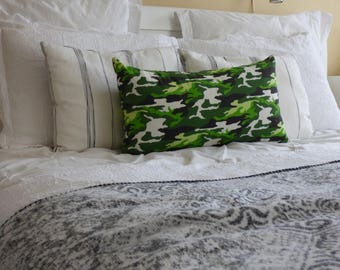 """Fresh and bright camouflage rectangular 14"""" X 24"""" pillow cover in green, brown, white.  Playful and happy for a child's room."""
