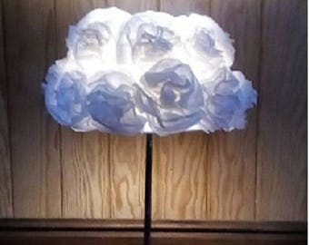 Other bedside lamp has white flower