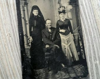 Tintype of a widow in full mourning attire and her family