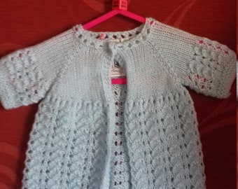 Hand knitted matinee jacket, knitted to fit a baby girl aged 0-3 months old