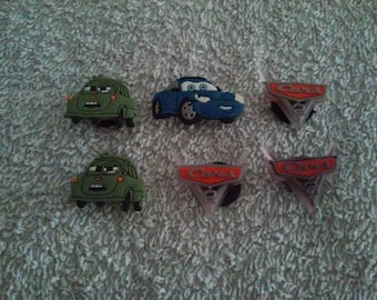 Lot 6 jibbitz Cars (badges for fangs)
