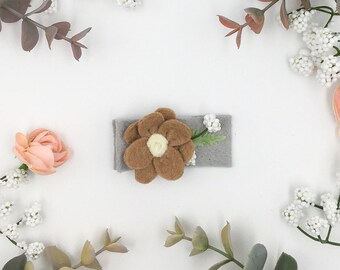Bitty floral clip tan felt flower