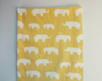 Organic cotton interlock knit fabric yellow elephants mod basics