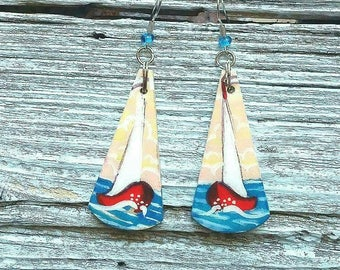 Wooden earrings. Travelling in the sea.