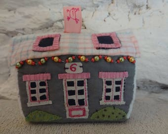 Little house in foam and textiles, toy or decoration.
