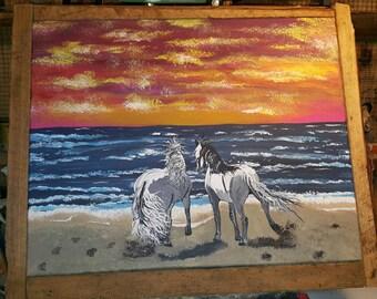 Stallions on a beach