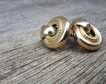 Goldtone hoop clip earrings