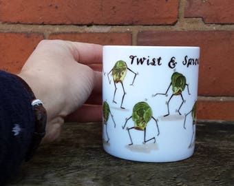 Twist and Sprout! Christmas China Mug design with illustrations by Alice Draws The Line; Brussels Sprouts doing the twist on tea/ coffee mug