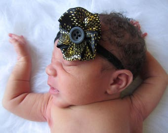 Blk and gold fabric flower with button center.
