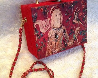 Red leather bag with print