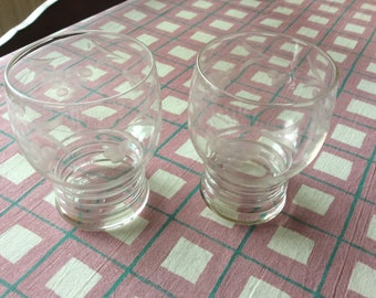 Two small etched tumblers