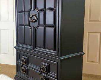 Black armoire (Thomasville) Dresser / Chest / wardrobe