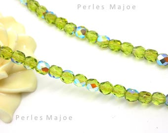 10 Czech glass oval faceted green iridescent clear AB 4 mm beads