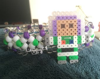 Buzz Lightyear perler on a large Kandi cuff bracelet