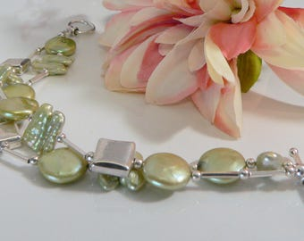 Freshwater Pearls with Sterling Silver Findings.