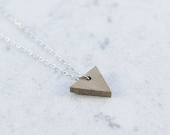 Triangle shaped necklace made of walnut wood,