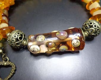 Bright necklace/Choker Lampwork focal bead, amber, Horn and bronze metal.